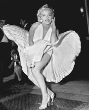 Marilyn Monroe poses over the updraft of a New York subway grating while in character for the filming of The Seven Year Itch in New York in 1954 wearing her iconic white dress. 