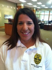 Laurie Scott, school resource officer at West Middle School, is leading the charge to provide kids with gifts and their families with food for the holidays through the new Lawrence Police Blue Santa Program. Scott joined leaders from several organizations Oct. 18, 2011, at Capital City Bank in downtown Lawrence to celebrate their organizations being chosen to receive proceeds from efforts conducted by the Lawrence St. Patrick's day Parade Committee.