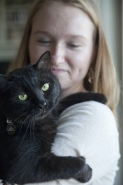 Dusty is a 6-year-old black cat that has mostly belong to Katie Evans in the Evans' household that includes other pets. Dusty was a rescue cat in Virginia before moving with Evans to Lawrence.