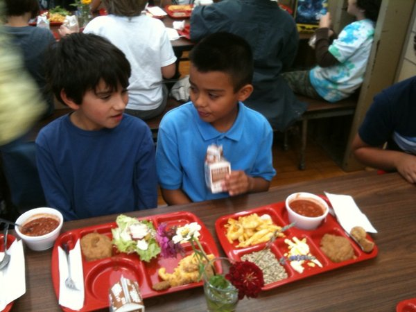 "Giovanni Ventello, left, and Alejandro Martinez-Diaz, both third-graders, enjoy their ""Farm-to-School Lunches"" Wednesday, Oct. 19, 2011, at Cordley School. Giovanni picked radishes, lettuce and tomatoes at local farms and they were served on the day's salad bar. His mother, Jackie Stafford, helped organize the school's third ""Farm-to-School Lunch"" event."