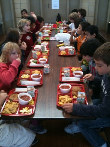 "Third-grade students at Cordley enjoy their ""Farm-to-School Lunches"" on Wednesday, Oct. 19, 2011. The lunches were made with food that was locally grown or produced. Some of the students picked produce that was served on the salad bar."