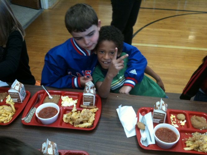 Trenton Snyder, left, and Silas Kriner, both third graders, ham it up for a picture during lunch on Wednesday, Oct. 19, 2011, at Cordley School. Snyder helped pick radishes and tomatoes at local farms for the salad bar that was served as part of lunch that day.
