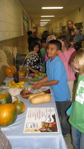 "Alejandro Martinez-Diaz, a third-grade student at Cordley, checks out a table of produce Wednesday, Oct. 19, 2011, before entering the cafeteria for a ""Farm-to-School Lunch."" The dishes that were served that day were locally grown or produced."