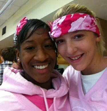 Cierra Hollins, left, and Caitlin Lewis, both freshmen at Lawrence High School, are sporting pink every day this month to support breast cancer awareness. Cierra is a cheerleader and hopes everyone wears pink to Friday's home football game.