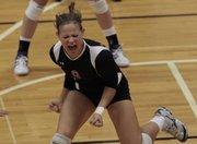 Lawrence High's Krista Costa celebrates a match point and a win in the Lions' volleyball match against Free State Thursday night at LHS.