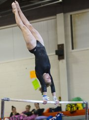 Free State gymnast Jackie Zaitz performs on the uneven bars during the 2011 Kansas 6A State Championship Saturday, Oct 22, 2011 at Shawnee Mission Northwest High.