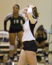 Free State's Samantha Landgrebe reacts following the Firebirds' loss to No. 1 seed Olathe East in the championship match of the 2011 Kansas 6A Sub State Volleyball Tournament Saturday, Oct 22, 2011 at Olathe East High School.