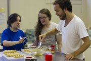 From left, Jordi Chervitz, Esther Tarshish and Max Clarkson make challah during a workshop. Profits from the sale of the bread will be donated to the Lawrence Community Shelter and Just Food.