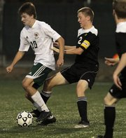 Free State's Jake Walter (10) tries to get to the goal against Topeka High on Tuesday, Oct. 25, 2011.