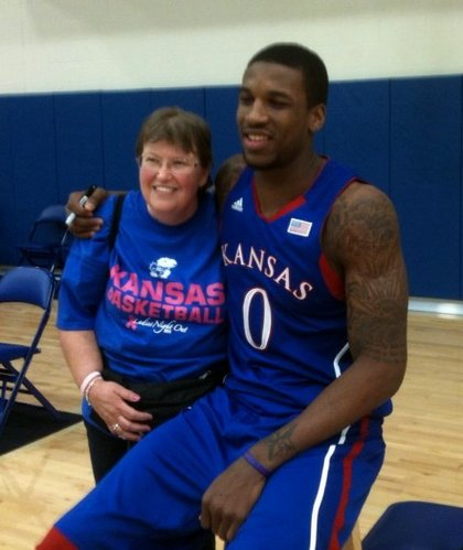 "Angie Herring, Lawrence, poses for a picture with  Kansas University basketball player Thomas Robinson during ""Ladies Night Out with Bill Self"" Thursday, Oct. 27, 2011 in Allen Fieldhouse. Herring, who is battling breast cancer, is a lifelong Jayhawk fan."
