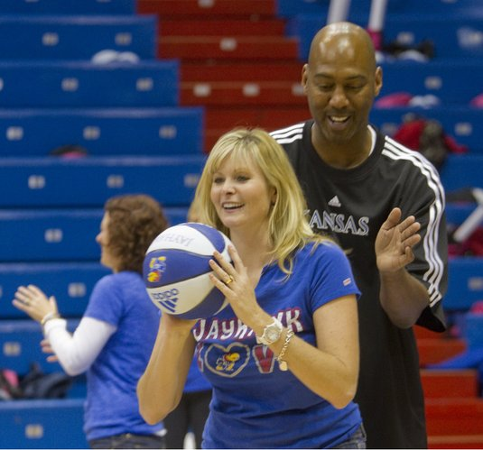 "KU assistant coach Danny Manning guards Kristi Woestendick, of Olathe, during ""Ladies Night Out with Bill Self"" in Allen Fieldhouse, Thursday evening, Oct. 27, 2011. Woestendick said her favorite part of the event was meeting the players and getting photos with them."
