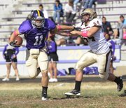 Haskell's Brandon Beaton (11) tries to get past Robert Morris' Jason Olson on Saturday, Oct. 29, 2011.
