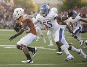 Kansas special teams player Michael Reynolds looks to wrap up Texas returner Malcolm Brown on the opening kickoff Saturday, Oct. 29, 2011 at Darrell K Royal-Texas Memorial Stadium.