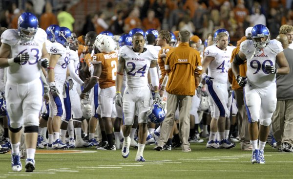 A frustrated Bradley McDougald (24) walks off the field after the Jayhawks 43-0 loss to Texas on Saturday, Oct. 29, 2011 at Darrell K Royal-Texas Memorial Stadium.