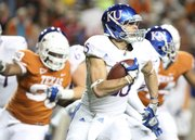 Kansas running back Brandon Bourbon turns up field against Texas during the third quarter on Saturday, Oct. 29, 2011 at Darrell K Royal-Texas Memorial Stadium.