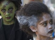 Amaya Mora, 7, as Frankenstein, left, and Ava Mora, 6, as the bride of Frankenstein make their way through downtown during annual Lawrence Trick-or-Treating event Monday night, Oct. 31, 2011.