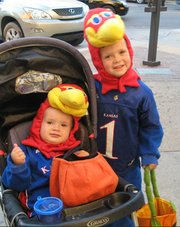 Big Jay (Logan Dinges, left) and Baby Jay (Carter Dinges) take a short break from trick-or-treating downtown on Monday, Oct. 31, 2011.