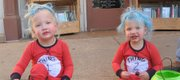 Two-year-old twins Jax and Croix Kelley trick-or-treated as Dr. Seuss characters on Massachusetts Street Monday, Oct. 31, 2011.