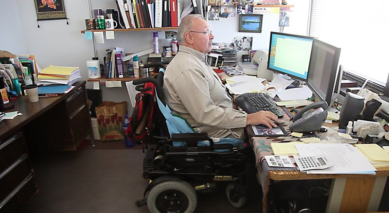 Glen White, director of Kansas University's Research and Training Center on Independent Living, works in his office on the fourth floor of the Dole Human Development Center. The center works in partnership with other colleges to research issues pertaining to people with disabilities and from that research it creates training programs to help them.