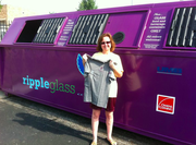 An example of Ripple Glass' purple containers that are spread throughout the Kansas City area and soon will come to Lawrence. In case you are wondering about the woman, she got a T-shirt from the company, according to Ripple's Facebook page.