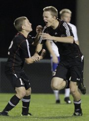 Lawrence High forward Luke Matthews, right, celebrates his goal in the first half against Olathe South in the 6A boys state soccer quarterfinals on Tuesday, Nov. 1, 2011 at ODAC.