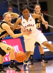 Emporia State's Rheanna Egli fights Kansas guard CeCe Harper for a loose ball Wednesday, Nov. 2, 2011 at Allen Fieldhouse.
