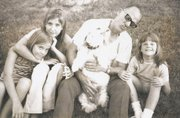 A 1974 photo of Kelly Barth, right. From left are her sisters, Kim and Karen; dog, Cindy; and father, George.
