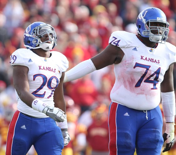 Kansas offensive lineman Jeff Spikes pats running back James Sims on the back after his fumble late in the second quarter on Saturday, Nov. 5, 2011 at Jack Trice Stadium in Ames, Iowa.