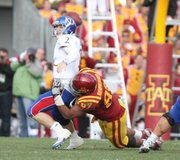 Kansas quarterback Jordan Webb is sacked on a crucial third down by Iowa State defensive lineman Stephen Ruempolhamer forcing the Jayhawks to punt late in the fourth quarter on Saturday, Nov. 5, 2011 at Jack Trice Stadium in Ames, Iowa. The Jayhawks lost to the Cyclones 13-10.