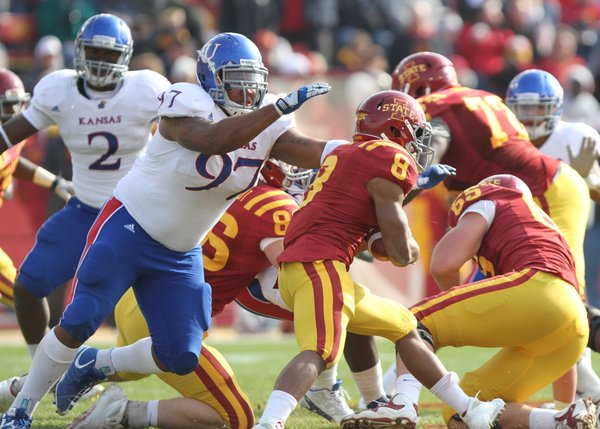 Kansas defensive tackle Richard Johnson Jr. looks to bring down Iowa State running back James White during the third quarter on Saturday, Nov. 5, 2011 at Jack Trice Stadium in Ames, Iowa. The Jayhawks lost to the Cyclones 13-10.