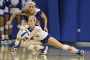 Kansas' Jamie Mathieu (14) gets low to dig the ball as Brianne Riley watches during Kansas' volleyball match against Texas Saturday, Nov. 5, 2011 at the Horejsi Center. Kansas fell to the Longhorns in five sets.