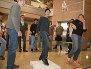 Team members Antonio Schoneich, right, Richard Lu, center, and Ruben Ghijsen, left, launch their spring device in the vertical leap competition at the 2011 High School Design Competition Tuesday at Kansas University's Eaton Hall. Area teams were to design and build small, self-propelled devices that can leap vertically, horizontally and at an angle.
