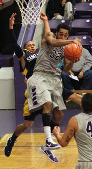 Haskell junior Jonn Garrick (32) pulls a rebound away from St. Mary's' Brandon Dougherty on Tuesday, Nov. 8, 2011.