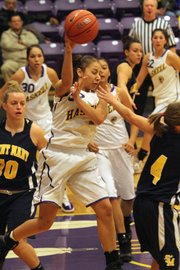 Haskell freshman Tiffany Sullivan tries to pass out of a trap by St. Mary's defense Tuesday, Nov. 8, 2011.