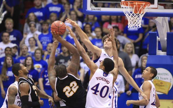 Kansas center Jeff Withey and forward Kevin Young, stuff a shot by Fort Hays State forward Markus Yarbrough during the second half on Tuesday, Nov. 8, 2011 at Allen Fieldhouse.