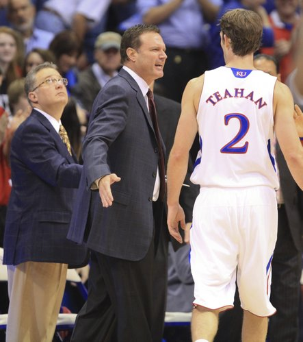 Kansas guard Conner Teahan gets a congratulatory pat from head coach Bill Self after a bucket during a timeout against Fort Hays State on Tuesday, Nov. 8, 2011 at Allen Fieldhouse.