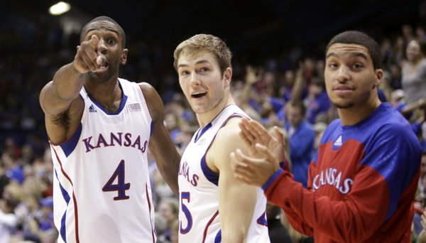 Kansas forward Justin Wesley, left, Jordan Juenemann and Niko Roberts look for acknowledgement from graduate assistant Brennan Bechard that the Jayhawks recovered a loose ball during a hustle play against Fort Hays State during the second half on Tuesday, Nov. 8, 2011 at Allen Fieldhouse. After the game forward Kevin Young explained that a failed recovery would mean running during practice for the team.