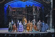 Snow falls on the cast members of the Broadway-style musical, A Dickens' Christmas Carol, at Silver Dollar City.