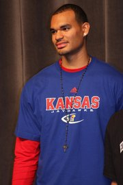 Perry Ellis officially signed a letter of intent with Kansas at Wichita Heights High School on Wednesday.
