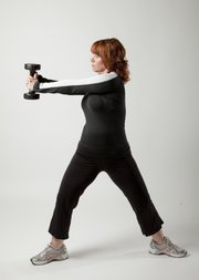 Twisted: Squat and raise arms shoulder height. Twist upper body to left and return to center. Repeat on right.