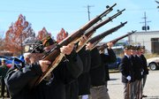 Veterans of Foreign Wars members fire a 21-gun salute Friday to honor military personnel on Veterans Day at VFW Post 852 in Lawrence.