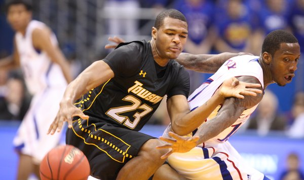 Kansas guard Tyshawn Taylor looks for a steal as he defends Towson guard Deon Jones during the first half on Friday, Nov. 11, 2011 at Allen Fieldhouse.
