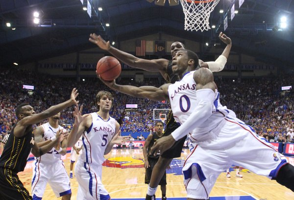 Kansas forward Thomas Robinson tries to hook a shot under the bucket amidst the Towson defense during the second half on Friday, Nov. 11, 2011 at Allen Fieldhouse.
