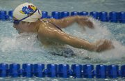 Kansas swimmer Deanna Marks finishes second in the 100-yard butterfly against Missouri on Friday, Nov. 11, 2011 at Robinson Natatorium.