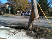 A utility pole was struck by a car south of 21st and Louisiana streets.