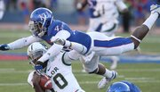 Kansas linebacker Malcolm Walker comes over the top of Baylor quarterback Robert Griffin III during the fourth quarter on Saturday, Nov. 12, 2011 at Kivisto Field.