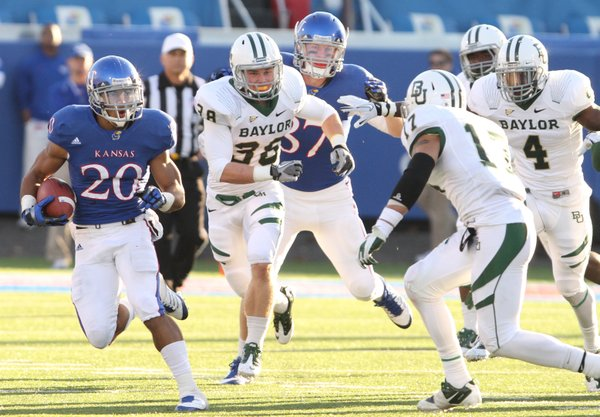 Kansas kick returner D.J. Beshears takes the ball up the field against the Baylor special teams unit late in the fourth quarter on Saturday, Nov. 12, 2011 at Kivisto Field.