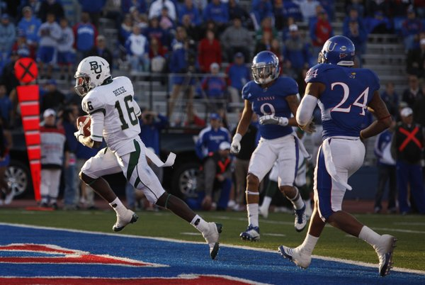 Baylor receiver Tevin Reese slips in for a touchdown past Kansas defenders Keeston Terry (9) and Bradley McDougald (24) during overtime on Saturday, Nov. 12, 2011 at Kivisto Field.