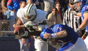 Kansas quarterback Jordan Webb tackles Baylor's Elliot Coffey after a turnover Saturday, Nov. 12, 2011 at Memorial Stadium.