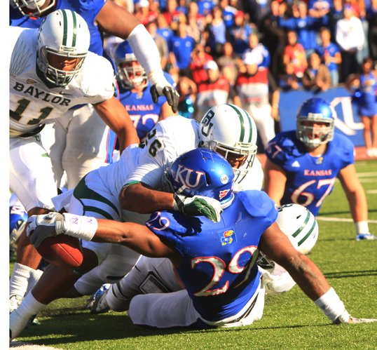 Kansas running back James Sims stretches the ball across the goal line for a touchdown against Baylor on Saturday, Nov. 12, 2011 at Memorial Stadium.